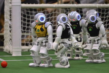 Humanoid robots compete during the 2015 Robocup finals in Hefei