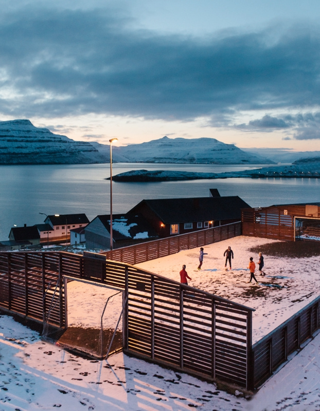 Children playing football in the village of Nes, Faroe Islands. March 2016.