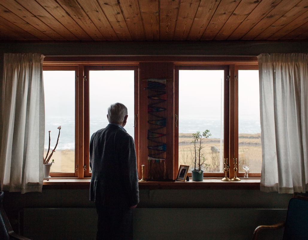 Joan Hendrick overlooking the Atlantic Ocean from his house in Kirkjabøur, Faroe Islands. March 2016.
